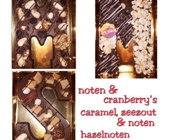 Met roomchocolade opgespoten chocoladeletter.